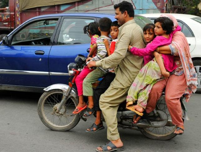 pakistani family celebrating world population day July 10, 2011